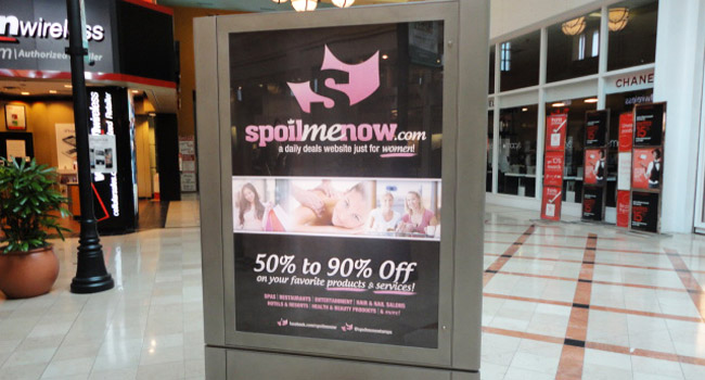 SpoiMeNow.com Print Ad in front of Macy's at Westshore Mall by Ryan Orion Agency